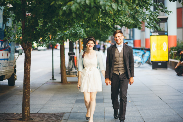 bride and groom walking down the street