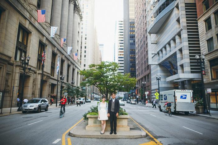 bride and groom portrait on traffic island