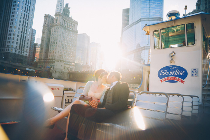 bride and groom kissing on ferry