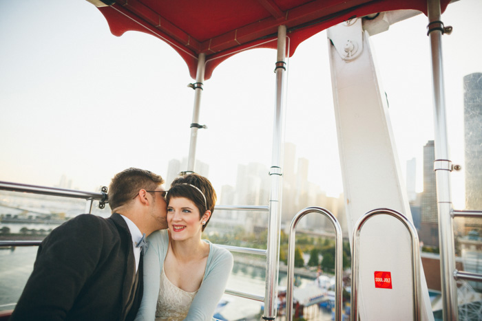 bride and groom on ferris wheel