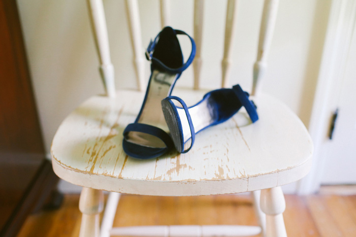 bride's blue shoes on chair