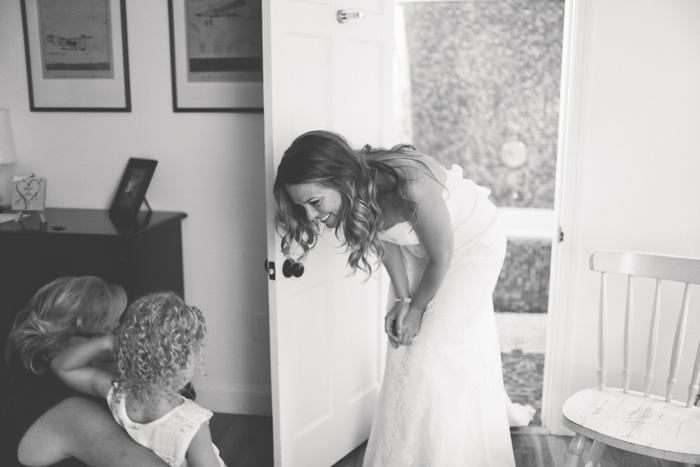 bride talking to flower girl