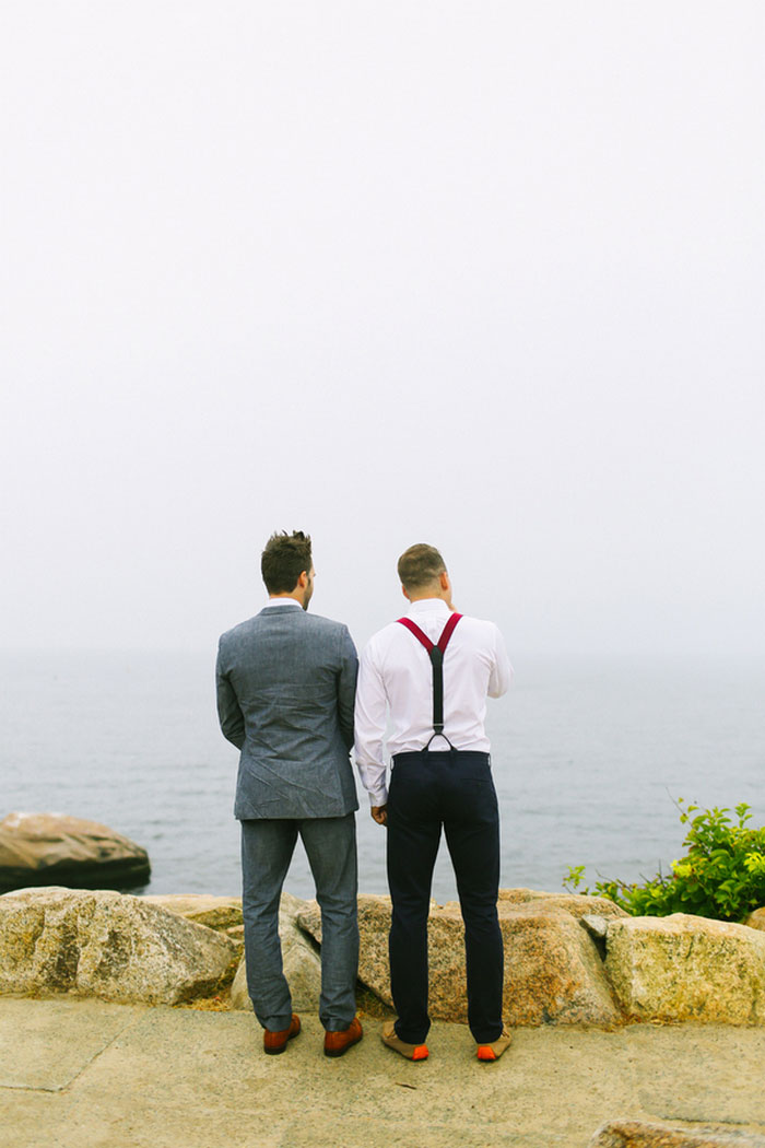 groom and best man waiting by the sea