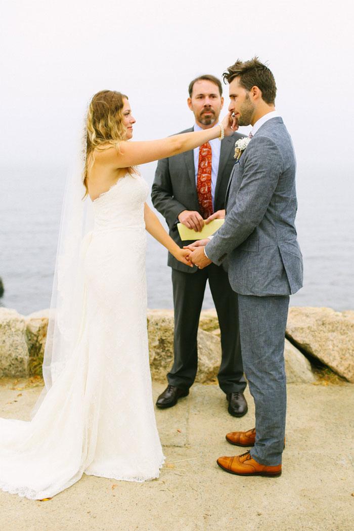 bride wiping away groom's tears