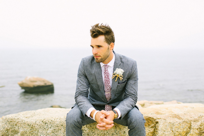 groom portrait by the sea