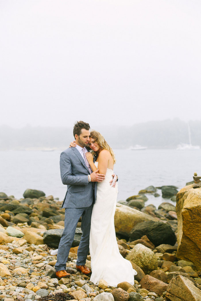 bride and and groom portrait by the sea