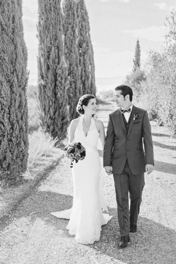 bride and groom walking in Tuscan countryside