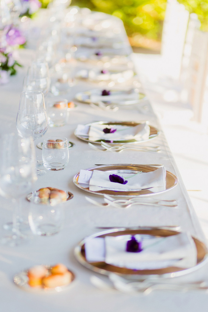table setting with purple flowers