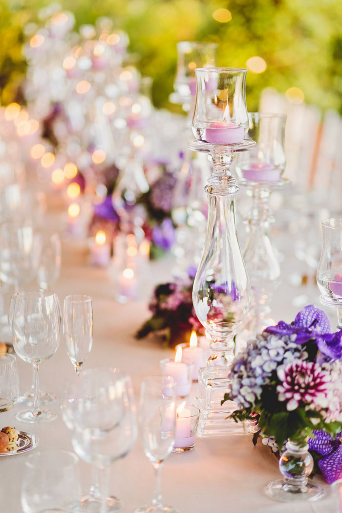 table setting with candles and purple flowers