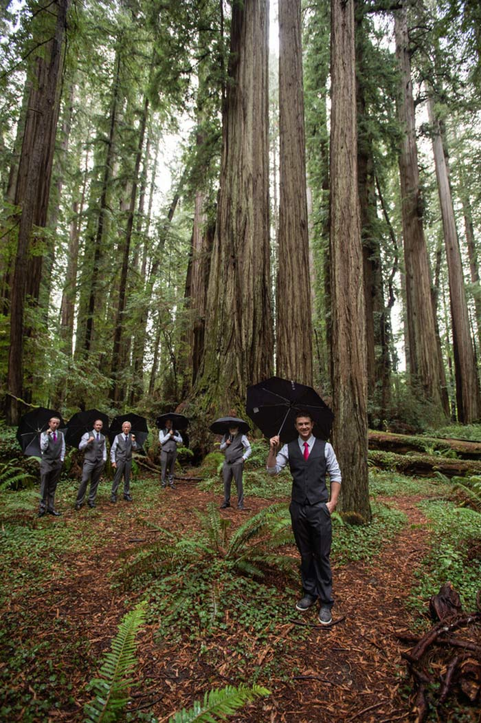 groomsmen portrait with umbrellas in the forest