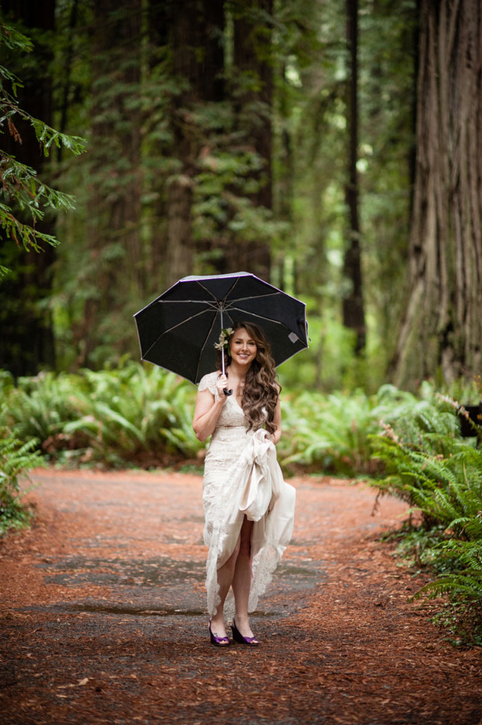bride in the woods with umbrella