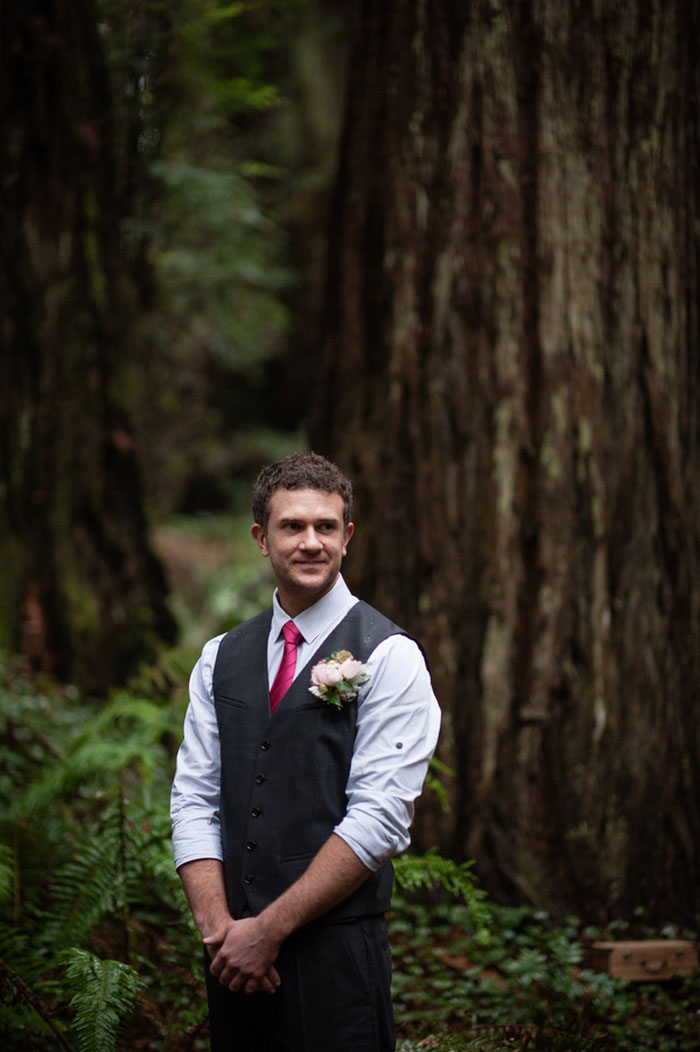 groomwaiting for his bride in the redwoods