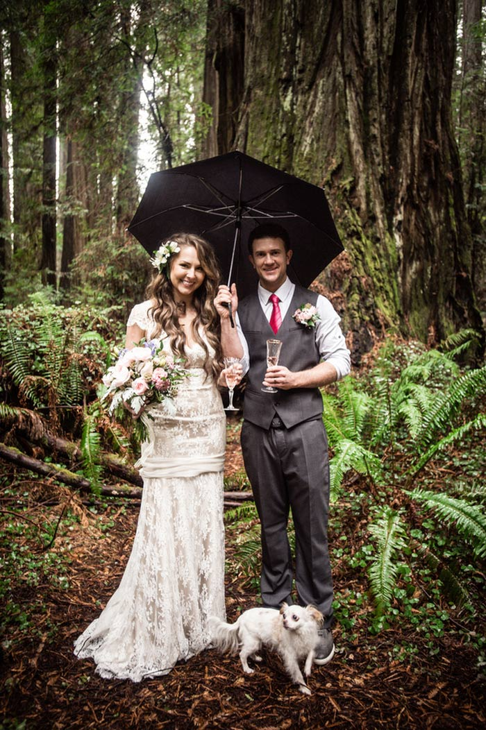 bride and groom portrait under umbrella in the woods