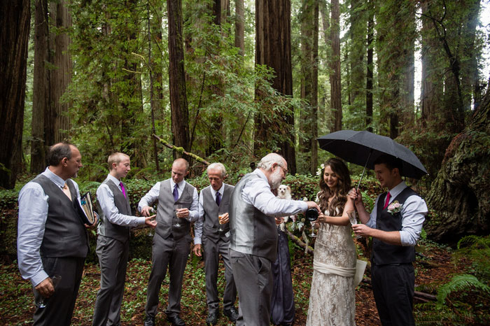 father of the bride pouring champagne in the woods