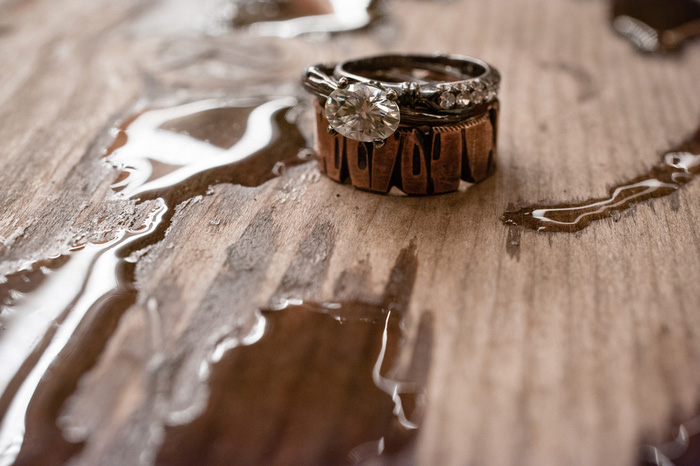 wedding rings on wet wood