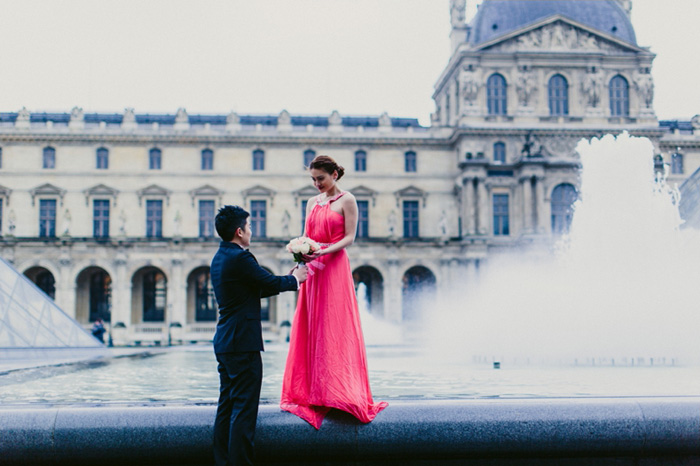 bride and groom by Paris fountain