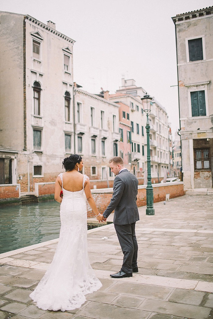 bride and groom by the canals in Venice