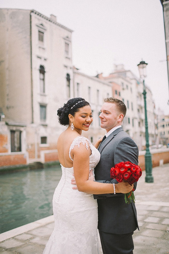bride and groom portrait by Venice Canal