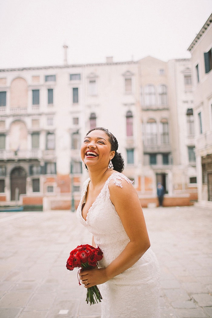 bride laughing in Venice square