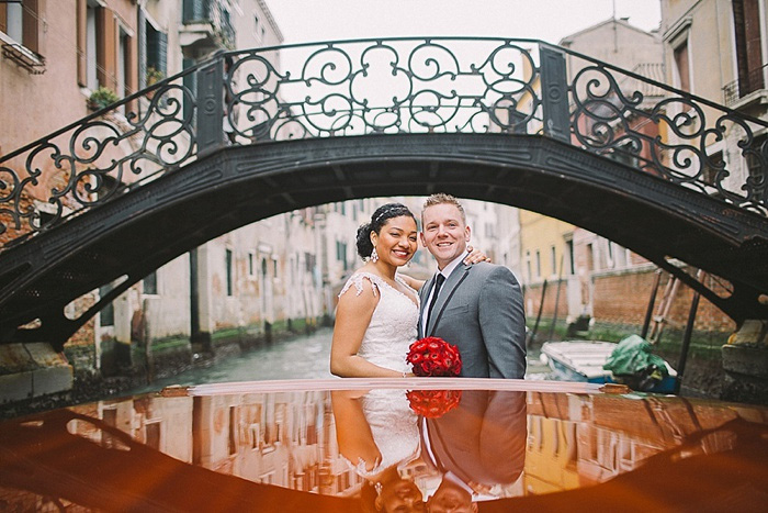bride and groom on boat in Venice canal