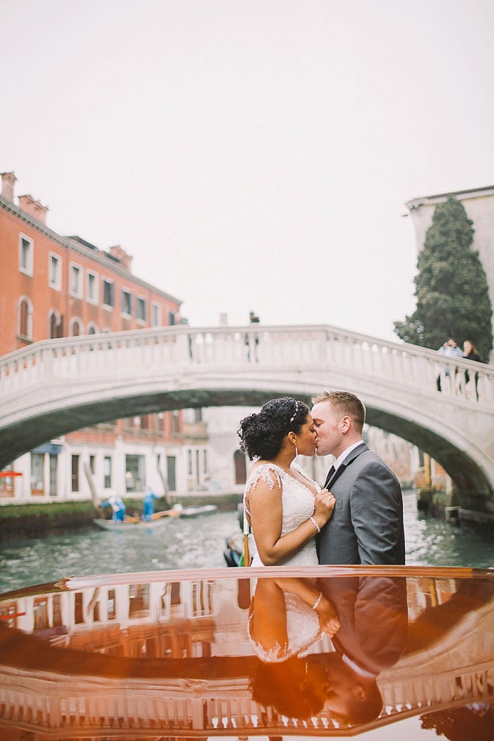 bride and groom kissing on canal boat