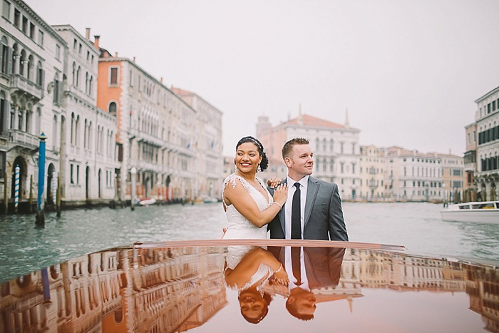 bride and groom in boat on Venice canal