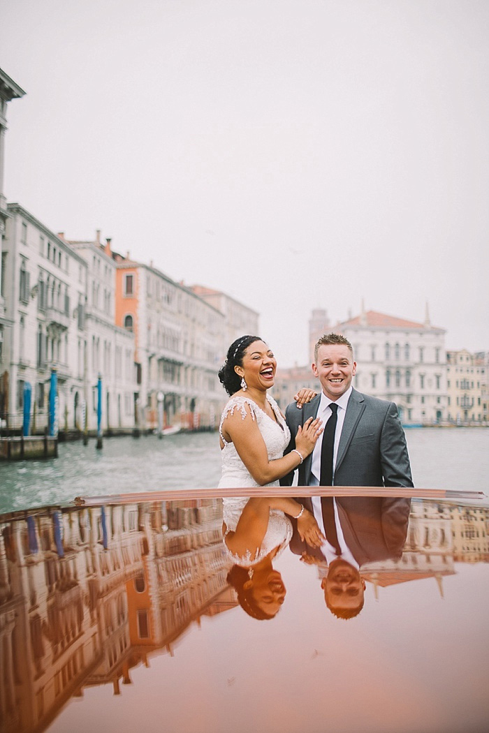 bride and groom on Venice canal boat