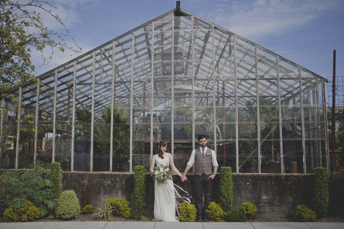 wedding portrait in front of greenhouse