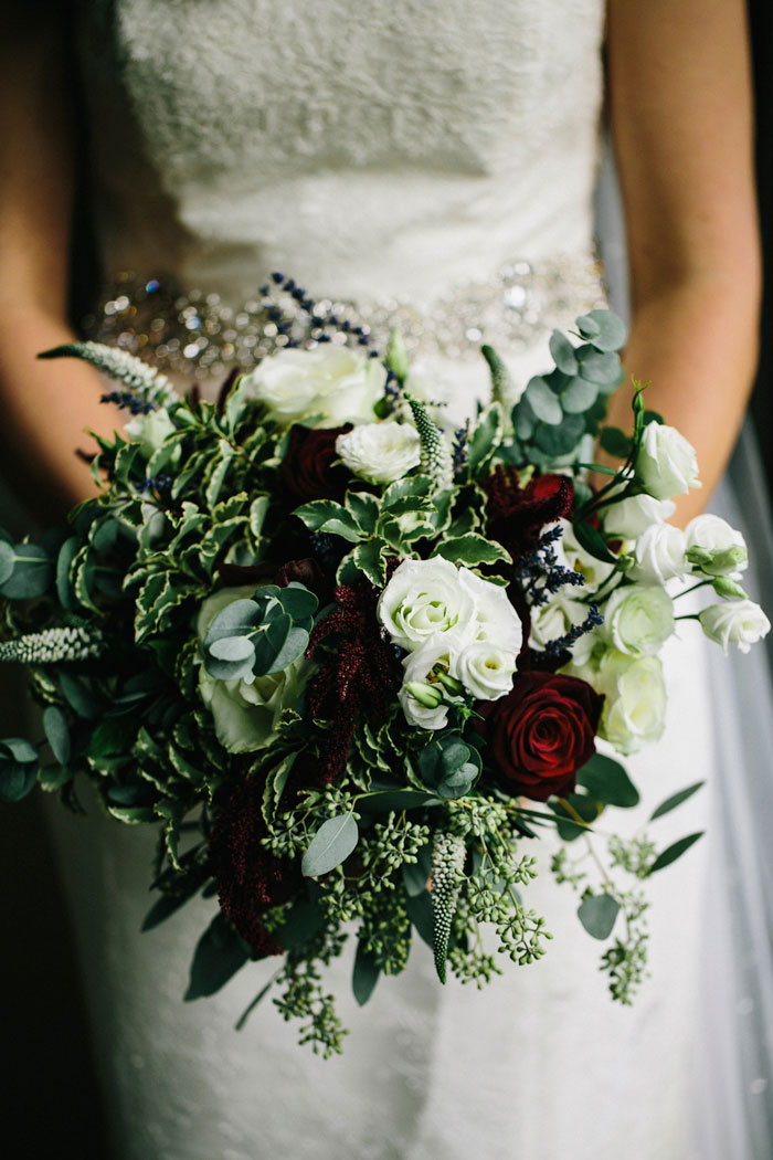 white, green, and red wedding bouquet