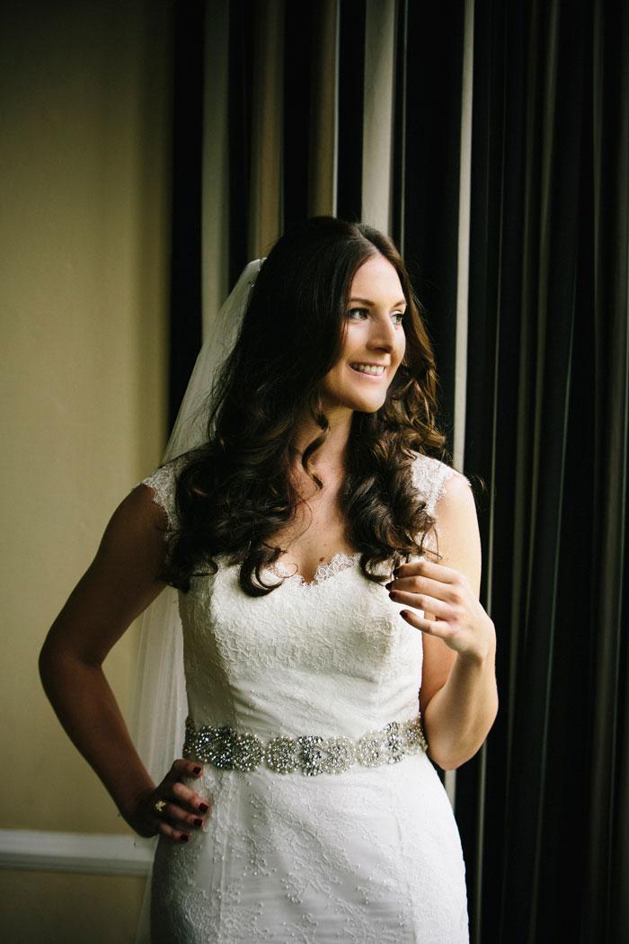 bride portait next to window