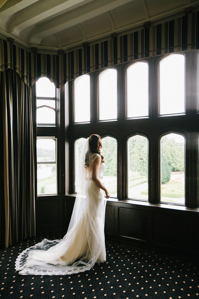 bride portrait looking out windows