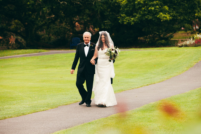 bride walking with her father to the aisle