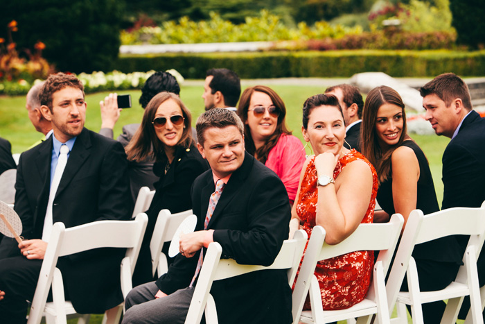 guests watching bride walk down the aisle