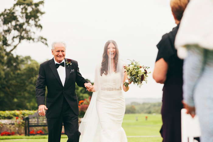 bride excited to be walking down the aisle