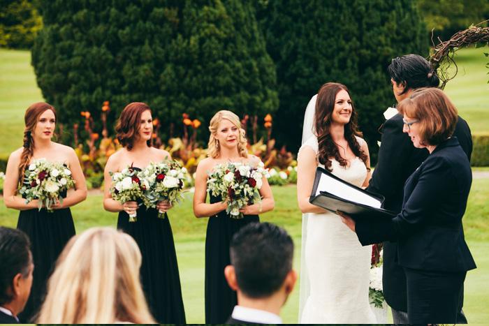 outdoor wedding ceremony on manor grounds