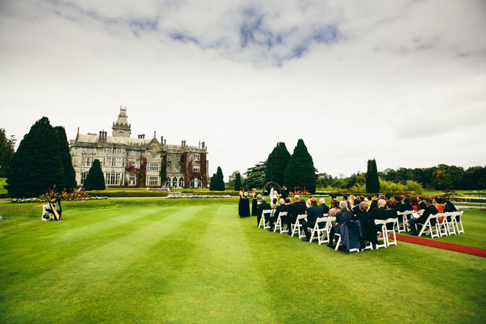 outdoor wedding ceremony on manor grounds