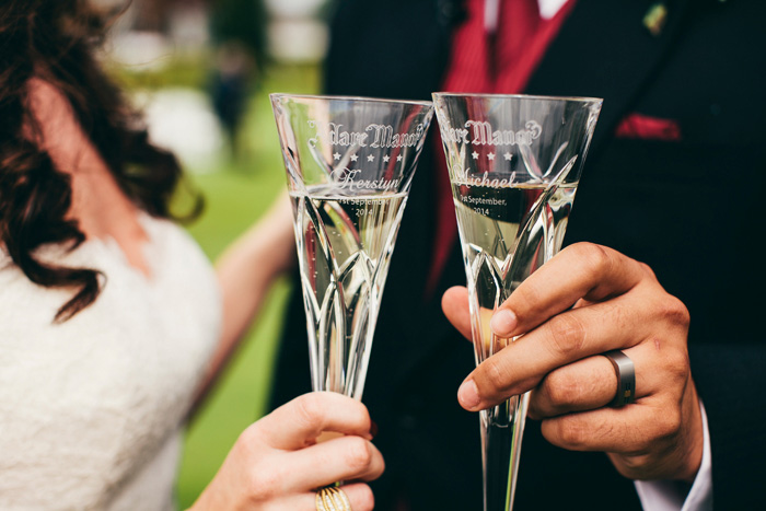 bride and groom holding champagne flutes
