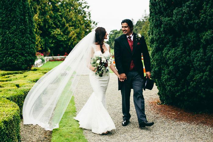 bride and groom walking on Irish Manor grounds