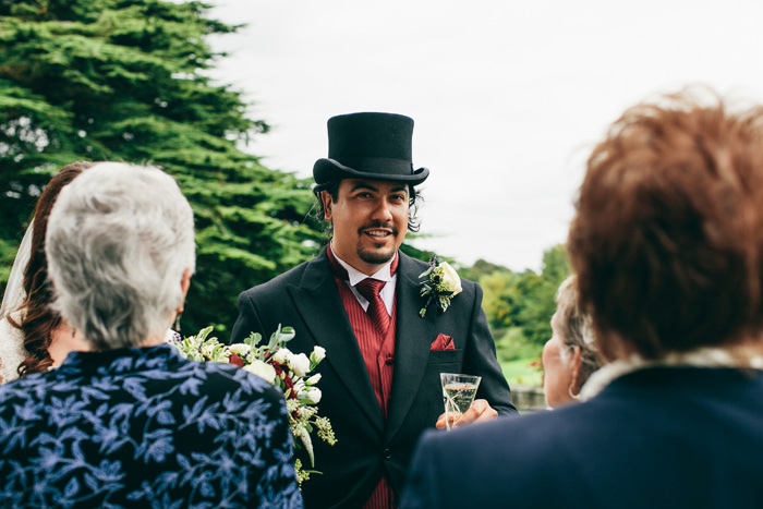 groom speaking with guests