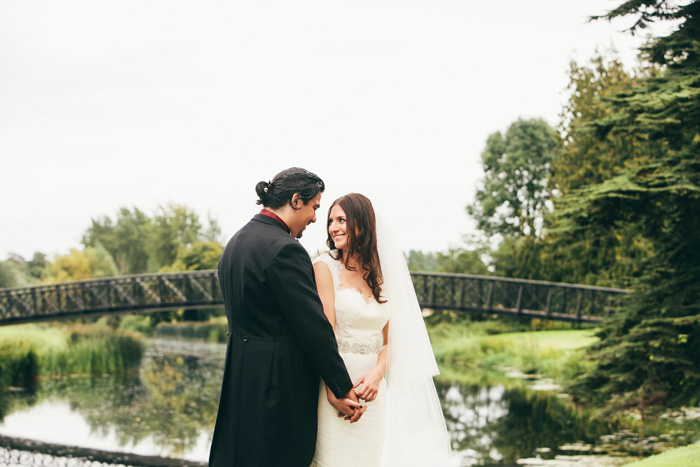 bride and groom portrait by pond