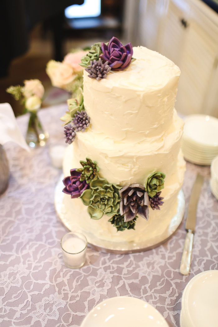 3-tier white wedding cake with succulents