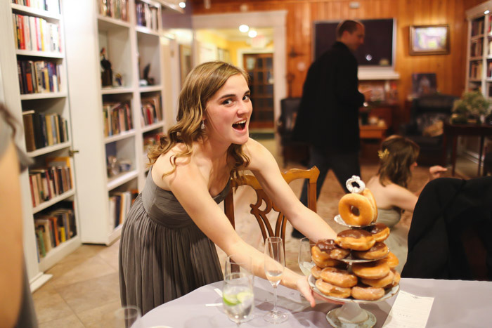 bridesmaid putting out donuts
