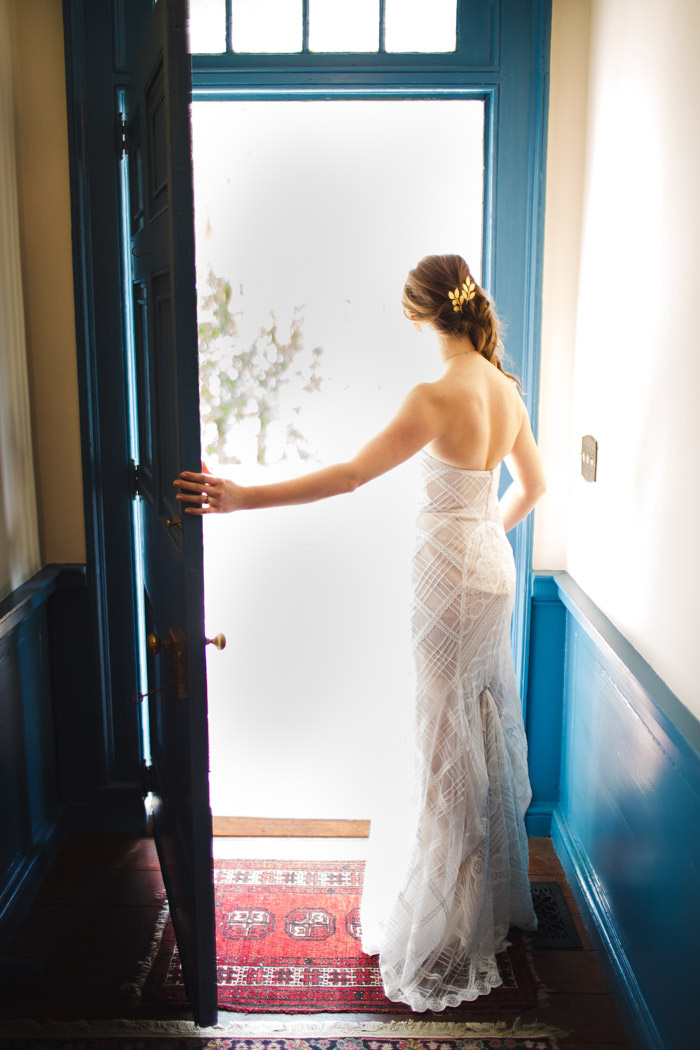 bride looking out door