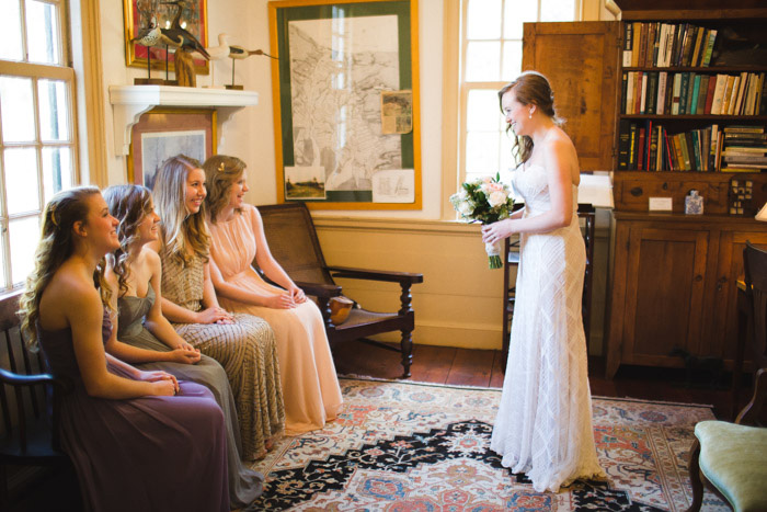 bride seeing her bridesmaids
