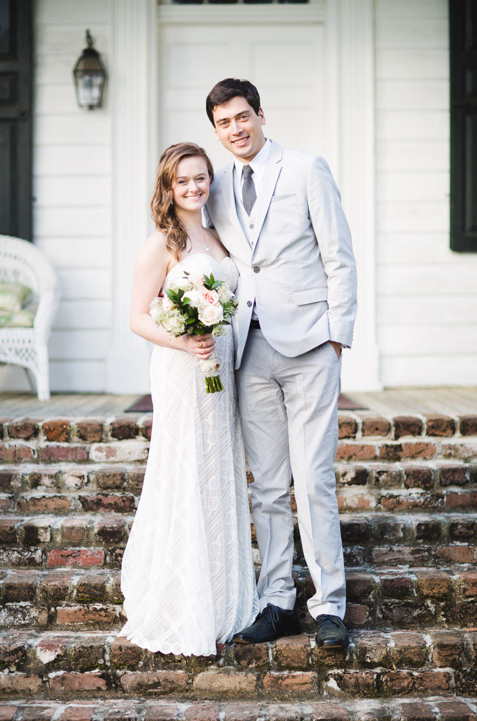 bride and groom portrait in front of plantation
