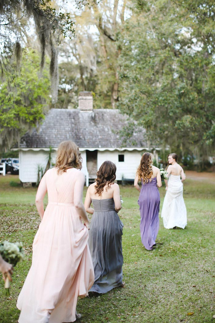bride heading to ceremony with her bridesmaids