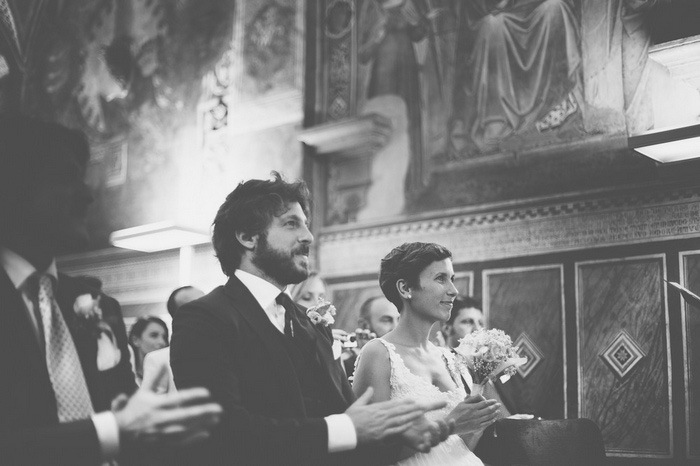 bride and groom sitting in Tuscan Church