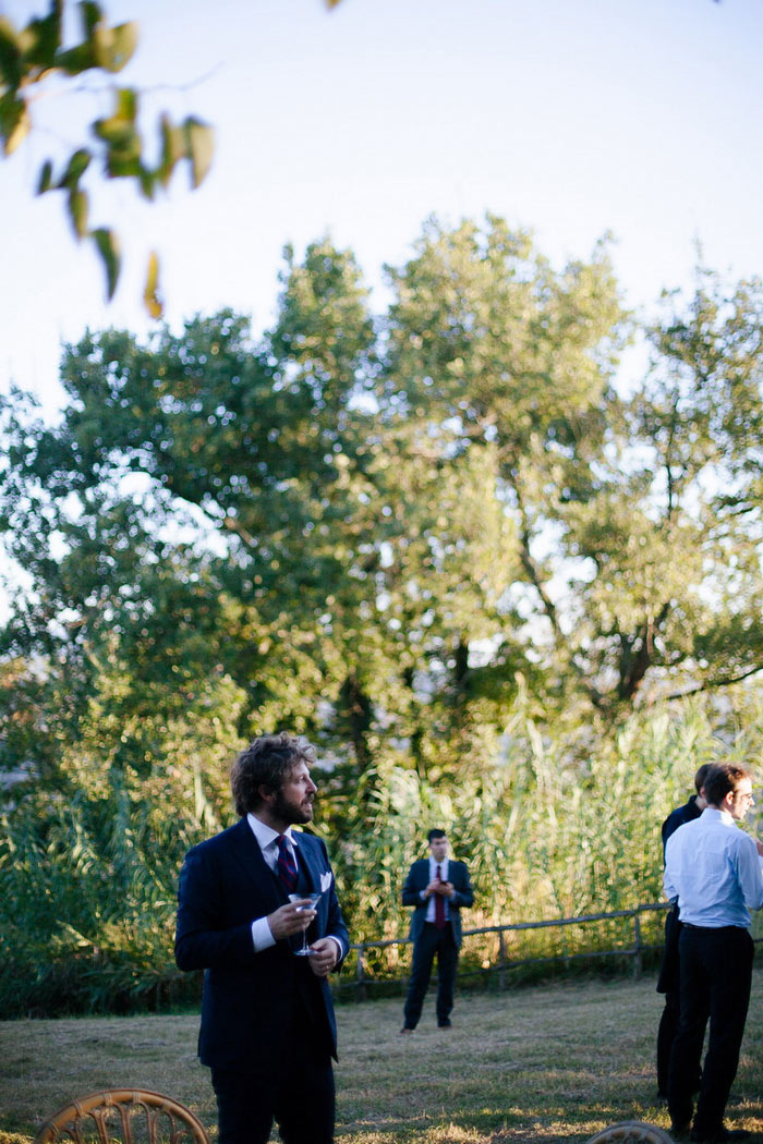 groom at outdoor wedding reception