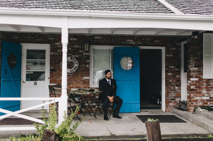 groom sitting on porch