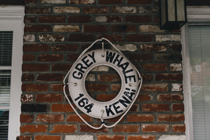life preserver on brick wall
